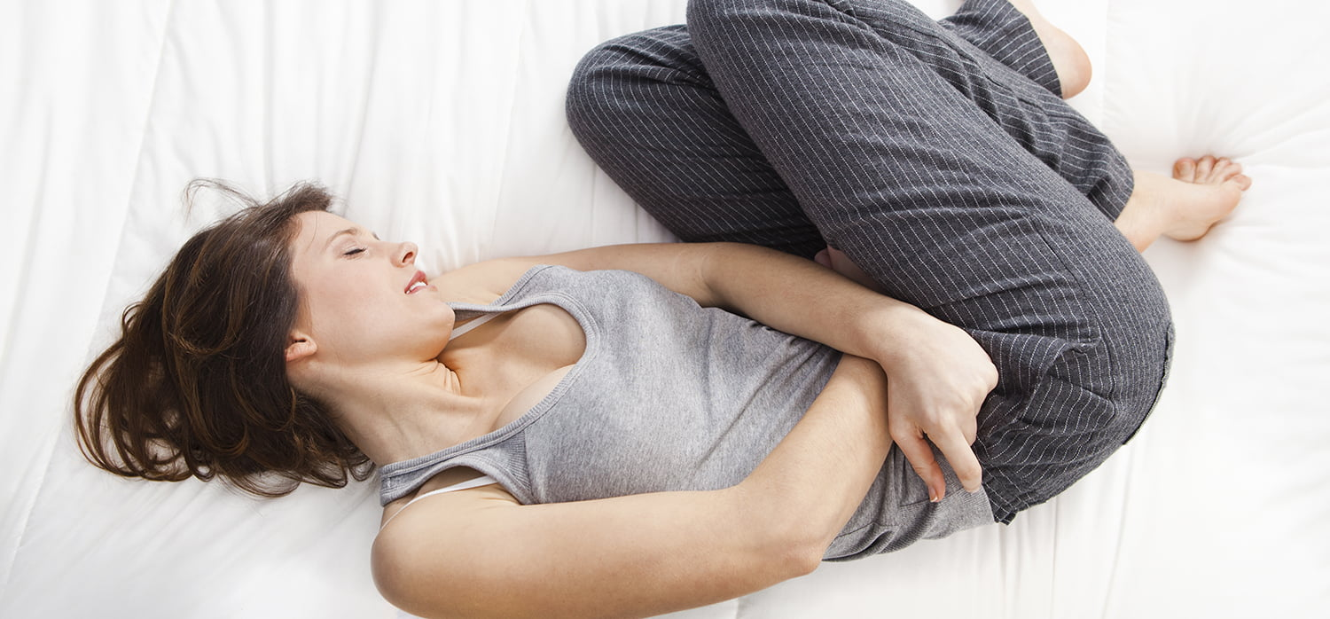Abdominal discomfort before or during menstruation